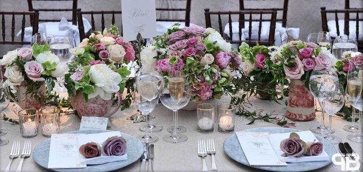 Romantic outdoor wedding tablescape with antique roses and lots of candlelight
