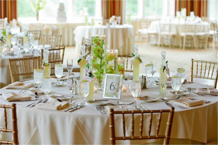Elegant wedding reception tablescape with green orchid centerpieces