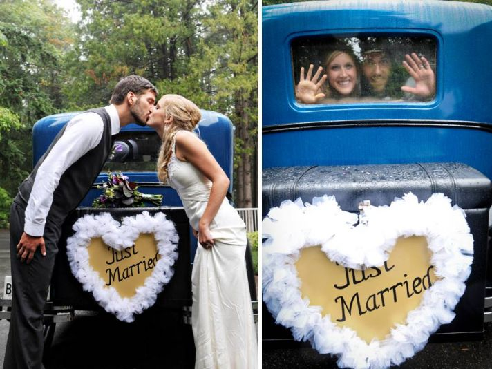 Bride and groom take vintage car for wedding day transportation