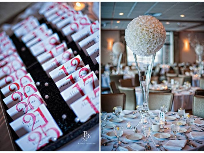 Black, white and red wedding reception escort cards; high floral topiary for table centerpiece