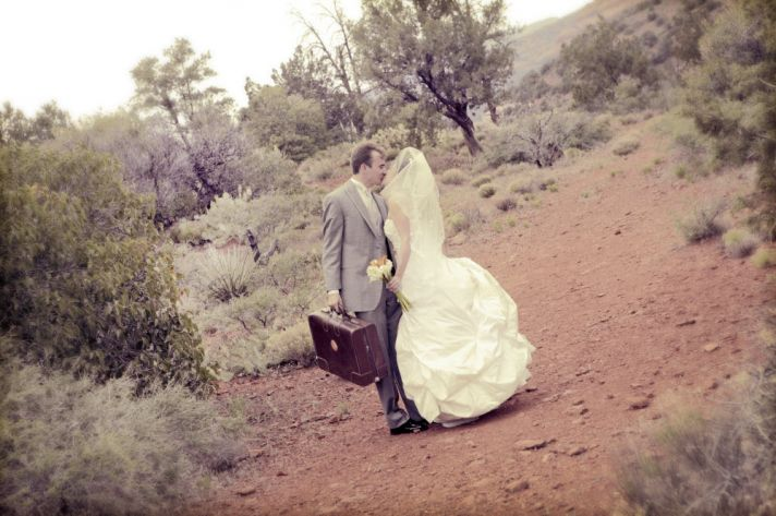 Bride and groom take couple's shots outside in Sedona, AZ