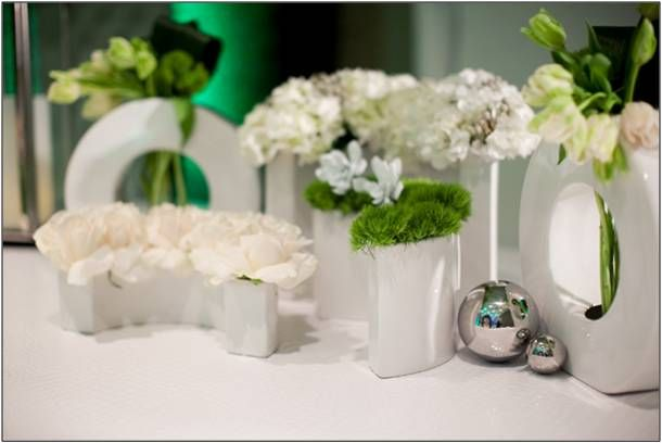 Modern and fresh white, green and silver wedding ceremony flower arrangements