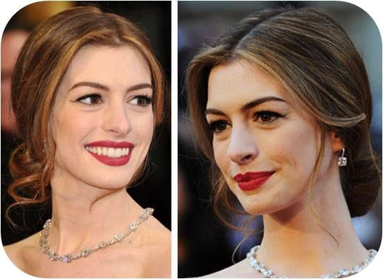 Anne Hathaway wore a sleek low chignon on the 2011 Oscars red carpet