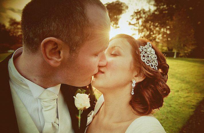 Irish bride and groom kiss outside castle wedding venue