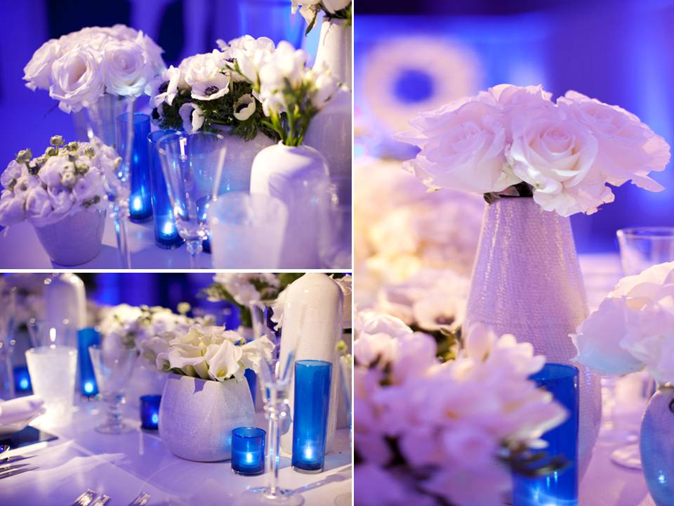 Modern wedding reception decor blue lighting white flowers and lounge
