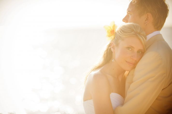 Beach bride and groom take romantic couples photo on the beach