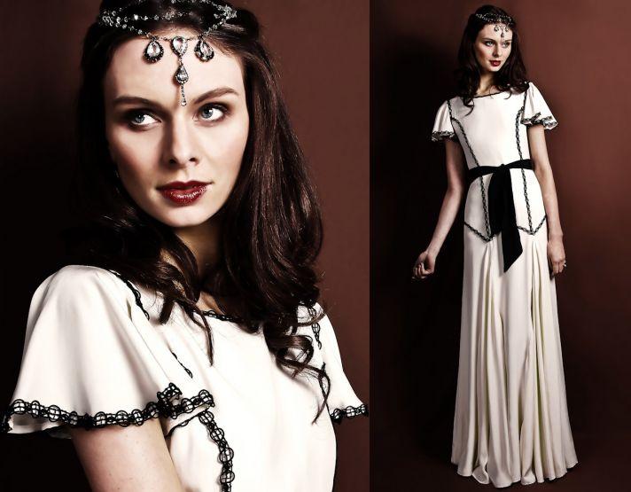 Ivory bateau neck bridal gown with black lace applique