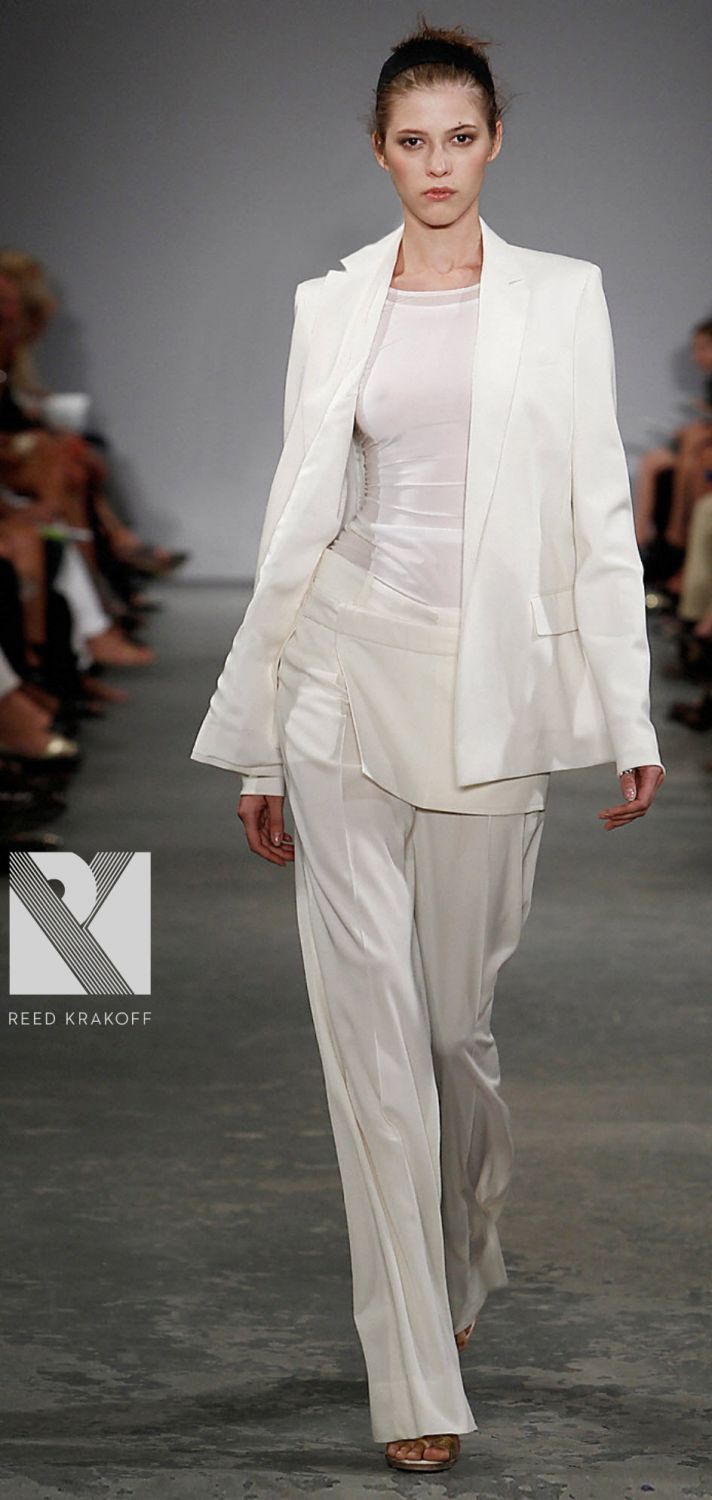 Chic Donna Karen all-white tailored suit with wide-legged pants and metallic belt