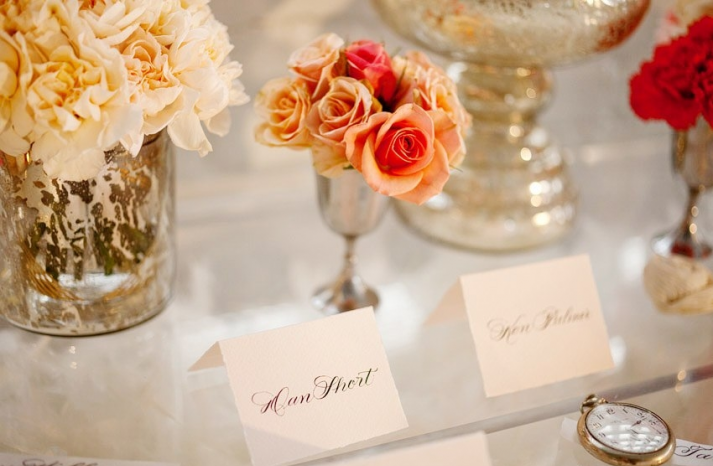 BHLDN-inspired-wedding-reception-decor-orange-flowers-escort-cards
