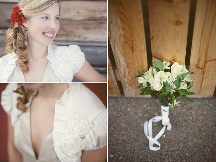 Casual vintage bride wears ivory bridal bolero and red hair flower