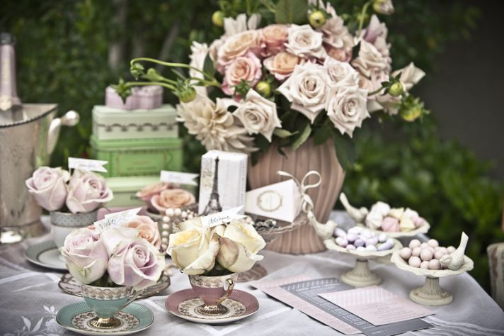 Romantic pastel DIY wedding reception centerpieces arranged in vintage