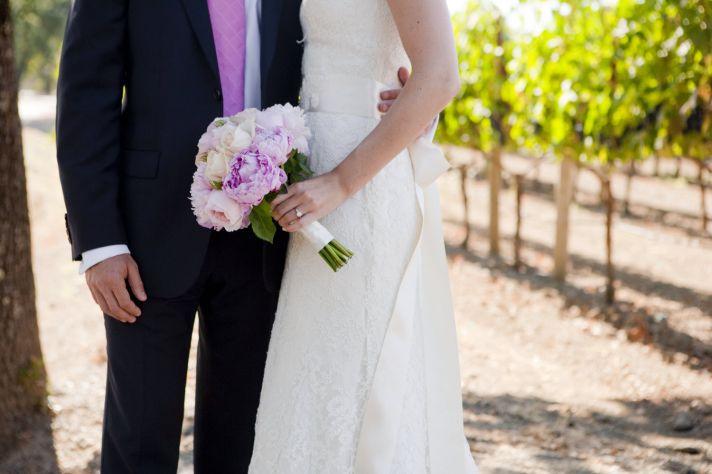 Outdoor Napa, California wedding- bride wears ivory lace wedding dress ,groom, is casual in black su