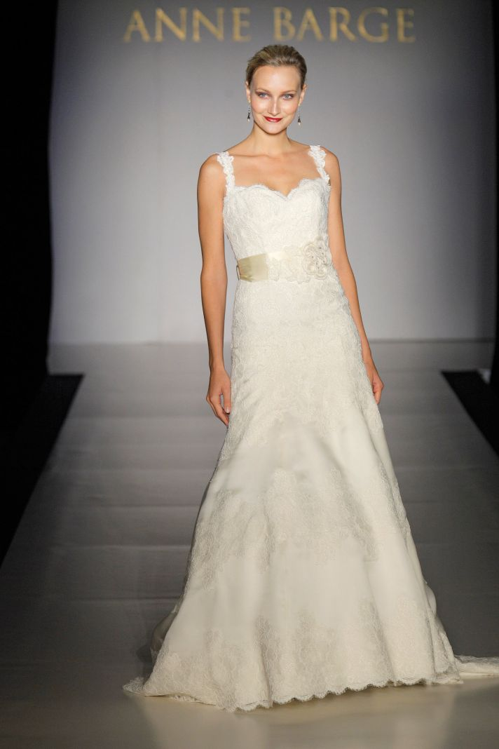Classic ivory lace a-line wedding dress with lovely lace straps and satin bridal sash