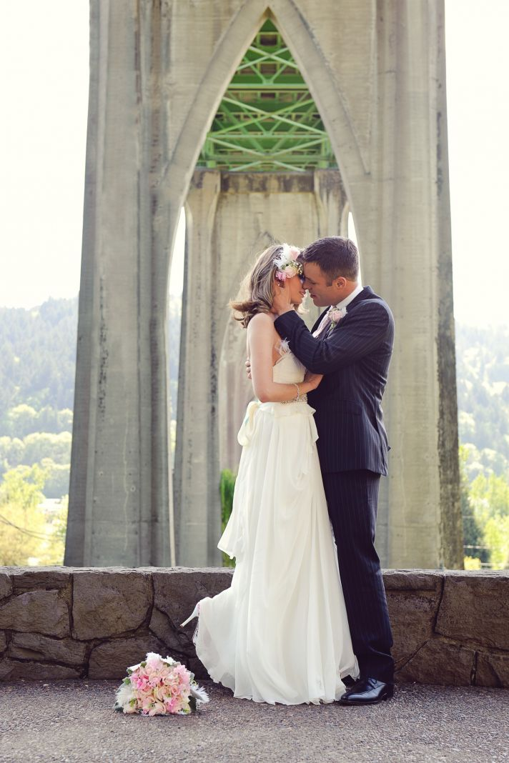 Bride and groom pose outside wedding venue after taking vows