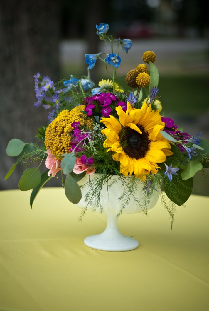 Sunflowers and wildflowers arranged for Colorado summer wedding