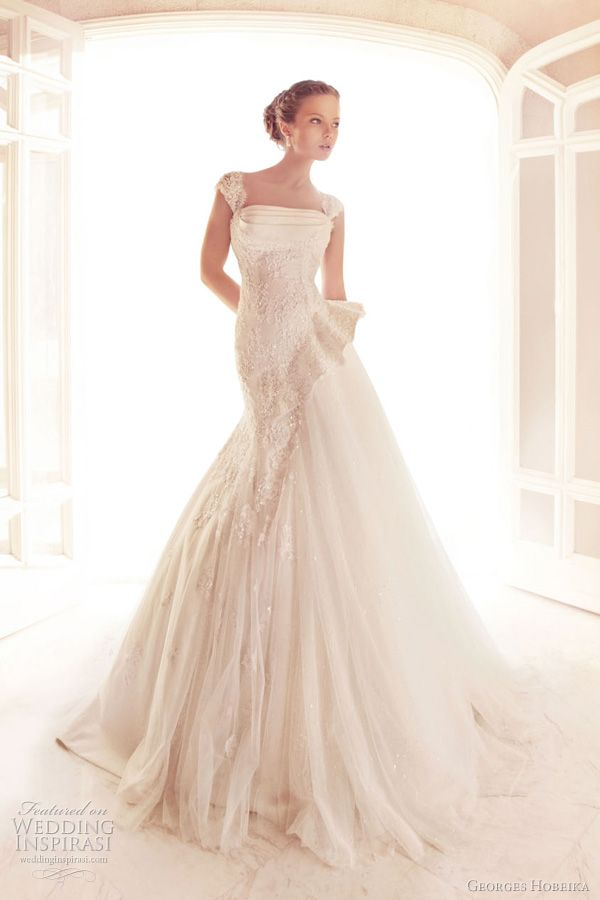 Cap sleeved wedding dress with ruffle detail