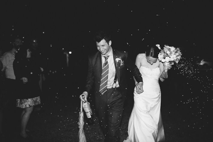 ROmantic black and white wedding photo-bride and groom exit wedding reception