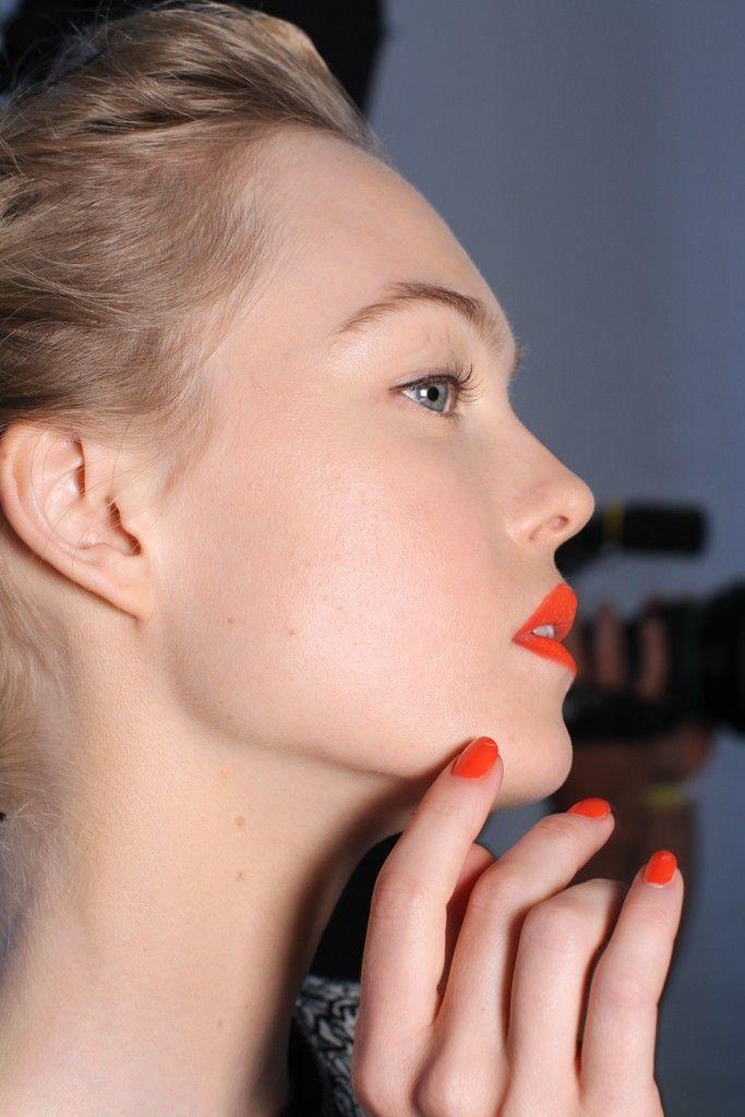 Dramatic bridal makeup- red lips, fake lashes red nail polish