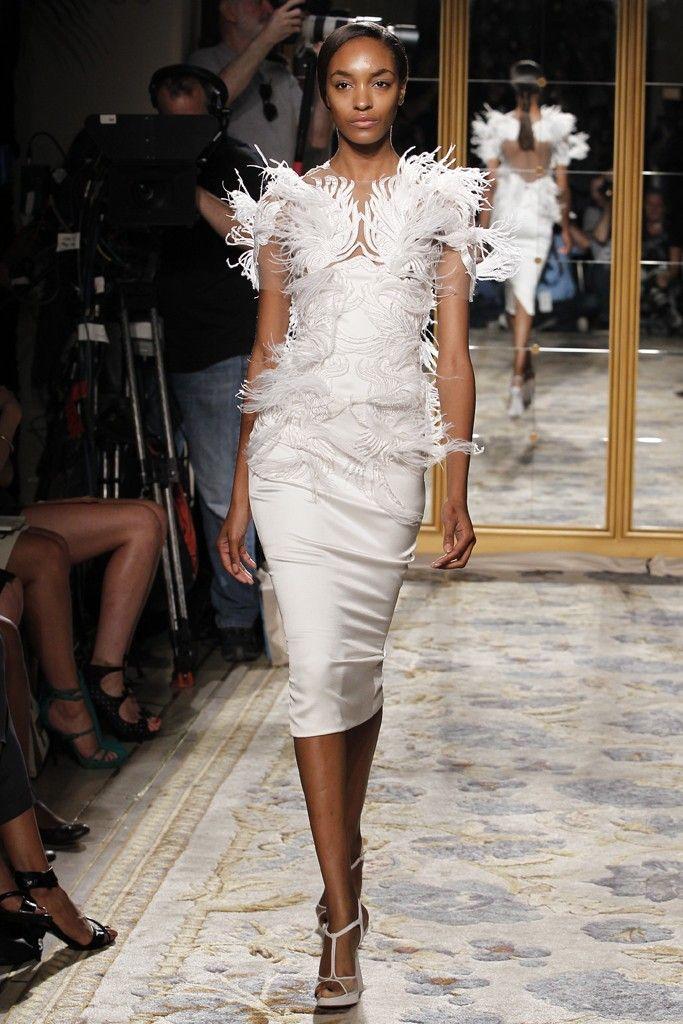 Sleek white wedding reception dress with feather bridal bolero