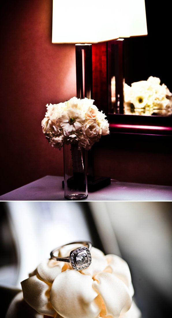 Cushion cut diamond engagmeent ring photographed on ivory wedding flowers