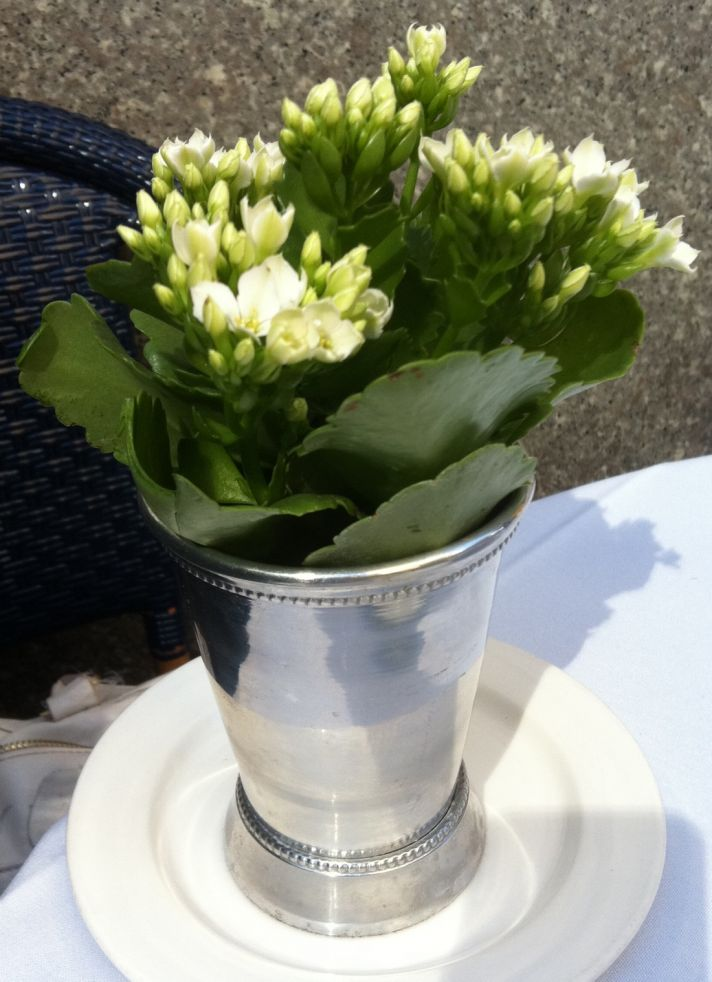 Ivory wedding flowers arranged in silver mint julep cups