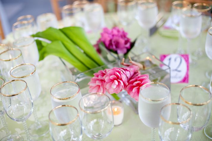Tropical pink wedding flowers at outdoor Indian wedding