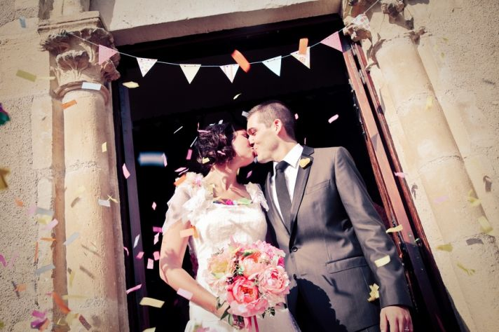 Bride and groom kiss after saying I Do