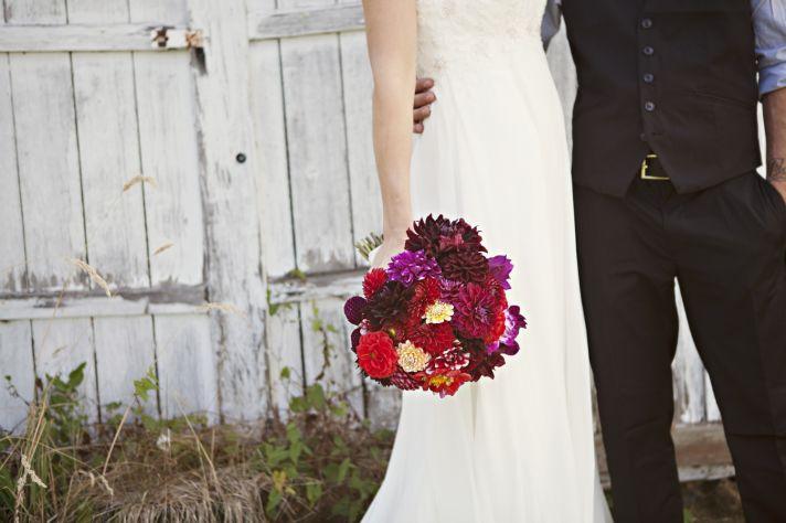 September bride holds bold bridal bouquet