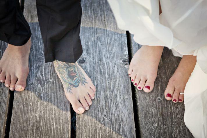 Tattood groom, barefoot bride