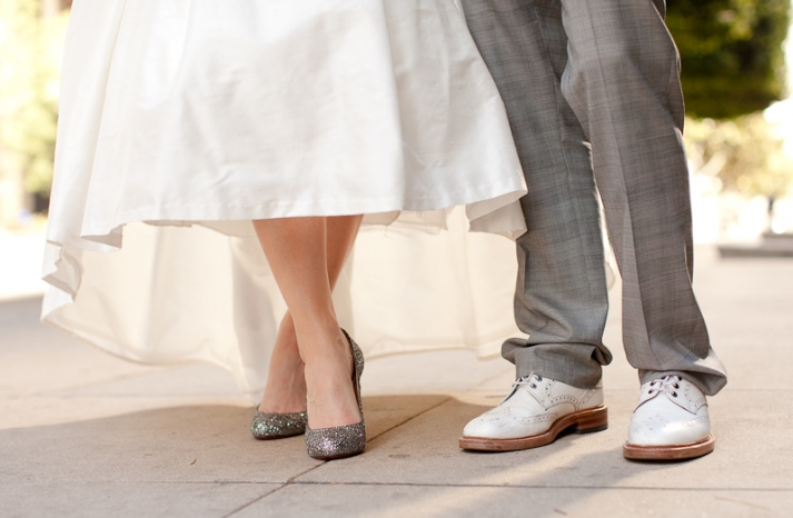 Bride-wears-white-wedding-dress-sparkly-wedding-shoes