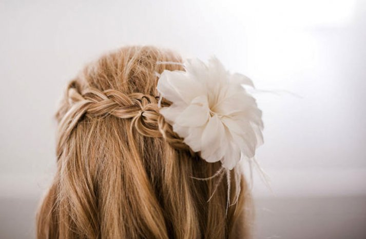 braided wedding hairstyle half up with flower