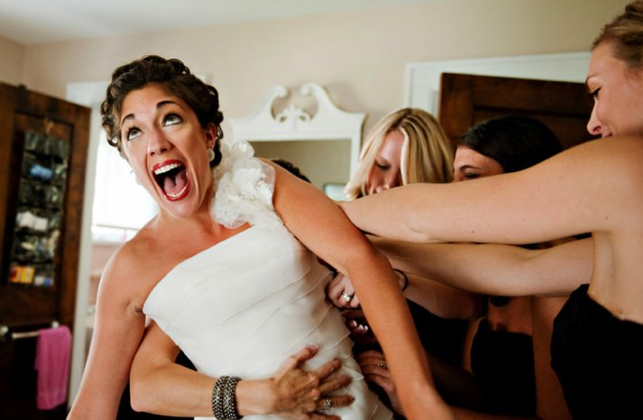memorable wedding photos day of photography bride squeezes into dress
