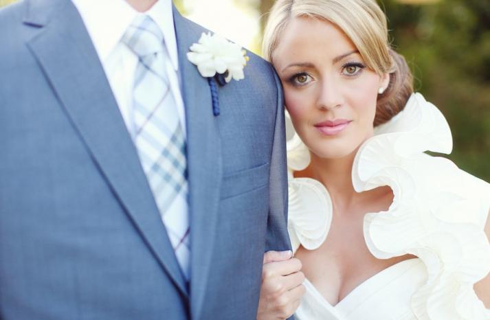 elegant grooms attire blue suit burberry tie bride in ruffled wedding dress