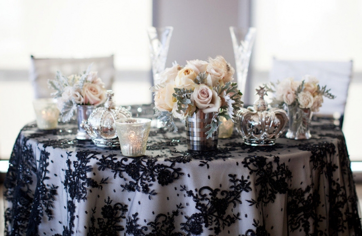 elegant wedding tablescape black lace overlay silver vases candles