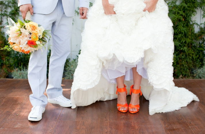 bride wears white wedding dress hot orange heels