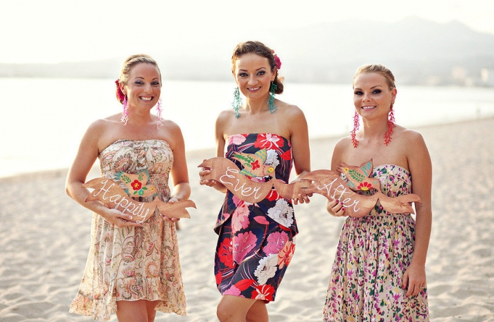 destination wedding bridesmaids wearing printed dress beach wedding