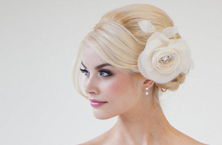 wedding hair flowers ivory classic chignon wedding hairstyle