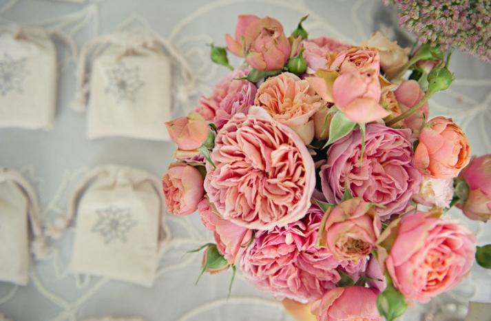 elegant real wedding outdoor reception under tent heavenly peach pink wedding flowers
