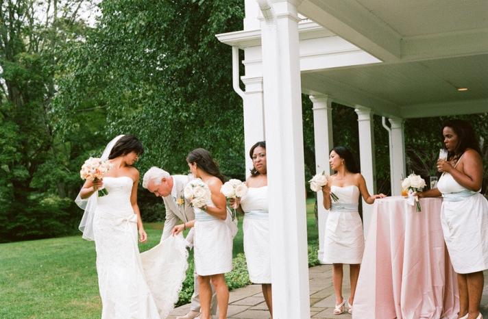 elegant real wedding outdoor reception under tent bride with her bridesmaids