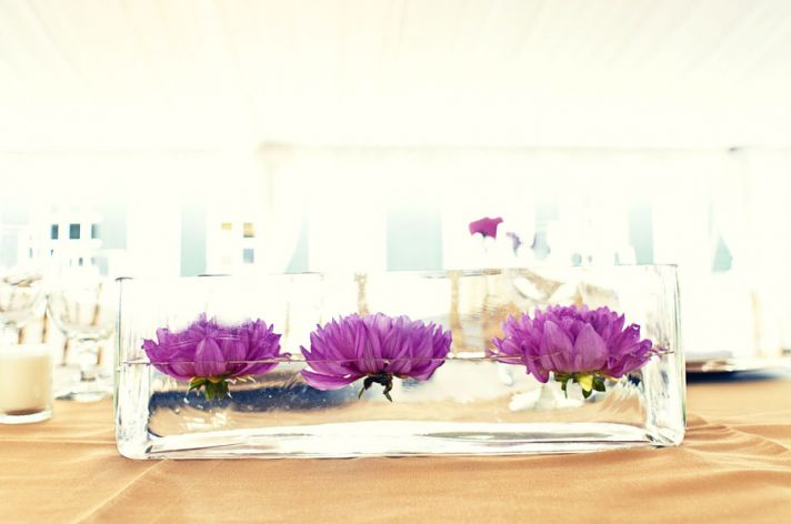modern wedding centerpieces hot pink purple flowers clear trough