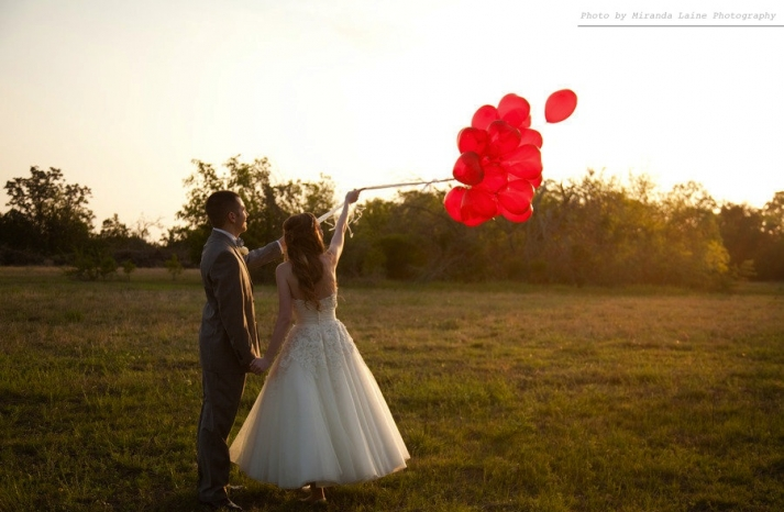 bride groom outside after wedding ceremony release balloons
