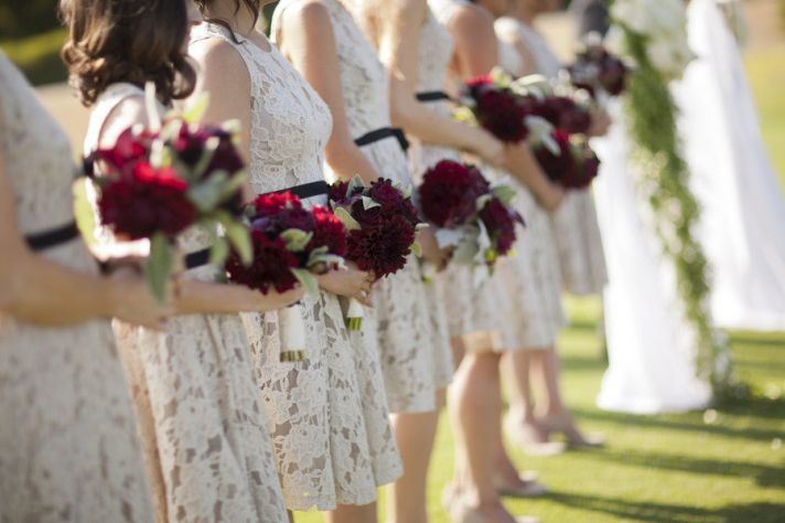 lace printed bridesmaids dresses black sash red bouquets