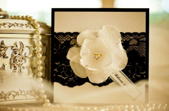 elegant wedding invitations with black lace applique and floral blooms
