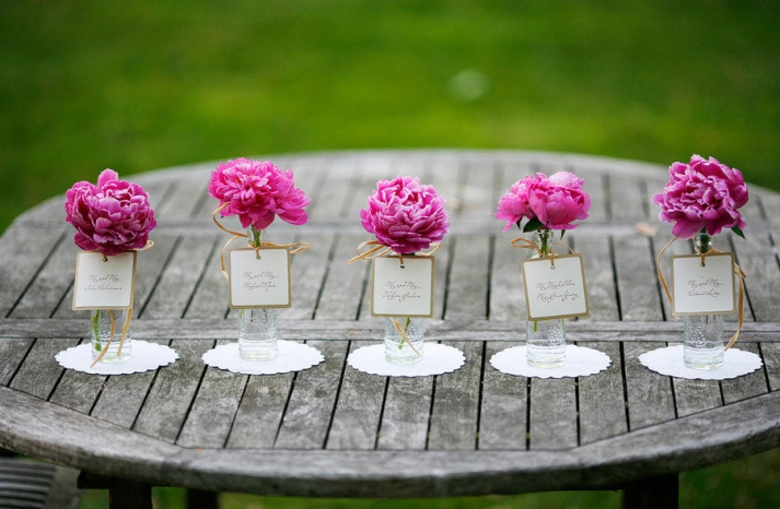 romantic spring wedding outdoor venue single bloom centerpieces pink peonies