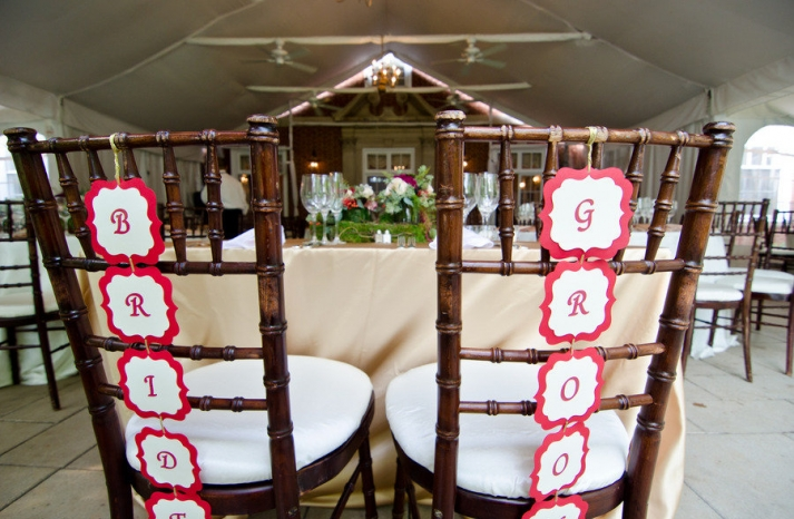 tented wedding reception bride groom chairs at sweetheart table