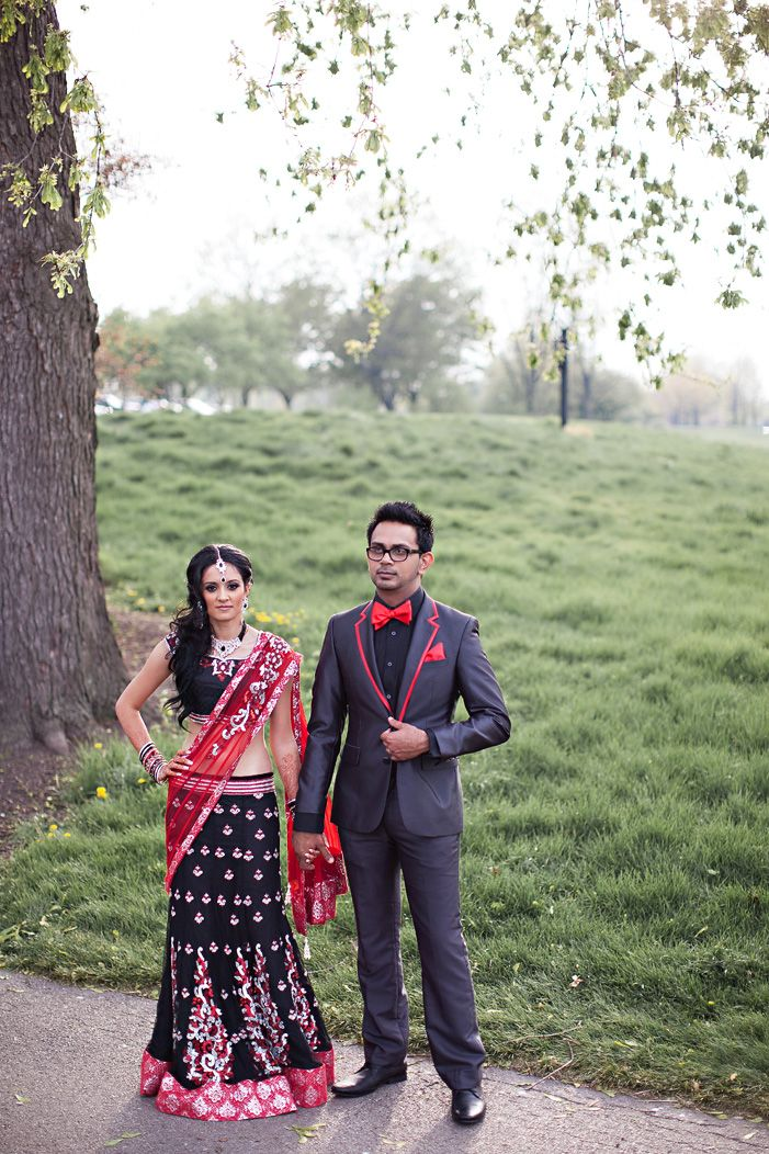 cultural real wedding Indian weddings Chicago IL black red bride groom attire for reception