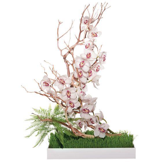 unique wedding centerpieces White cymbidium orchids umbrella fern wheatgrass manzanita branch