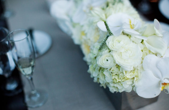 elegant ivory white wedding centerpiece roses orchids hydrangeas