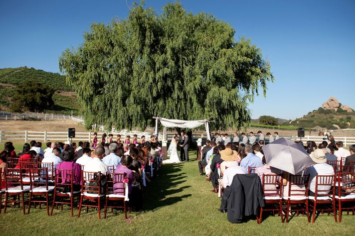 elegant California wedding with bold florals personalized details getting married under a tree