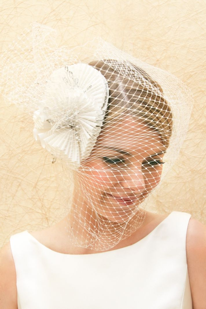 Wedding head chic for the bride and beyond bridal veils hair accessories by suzy orourke birdcage veil with flower junglespirit Image collections